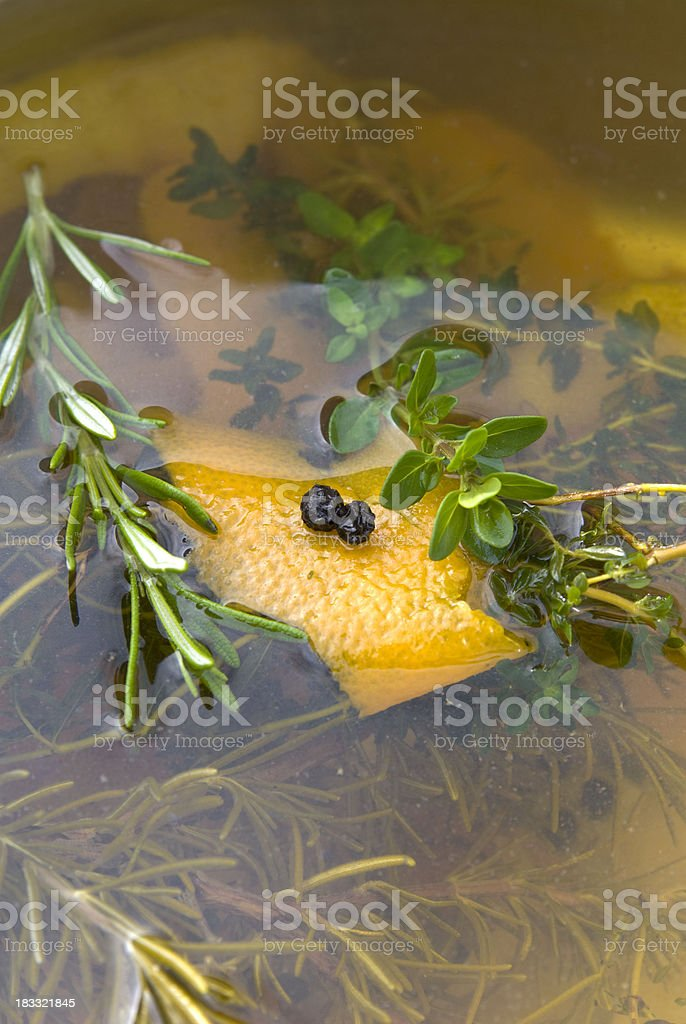 Thanksgiving & Christmas Holiday Turkey Brine with Citrus, Fresh Herbs & Peppercorns royalty-free stock photo