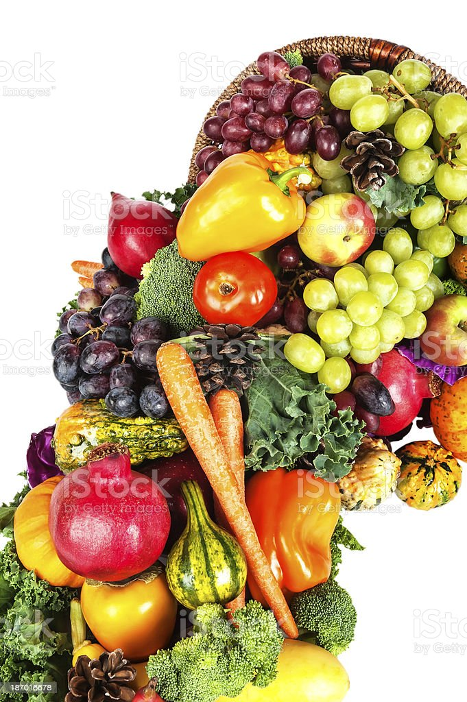 Thanksgiving cornucopia with fruit and vegetables isolated on white royalty-free stock photo