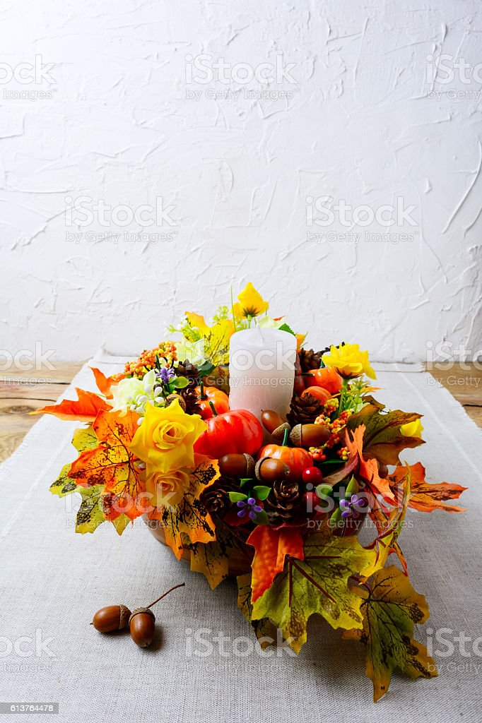 Thanksgiving decoration with silk fall leaves on linen napkin, v stock photo