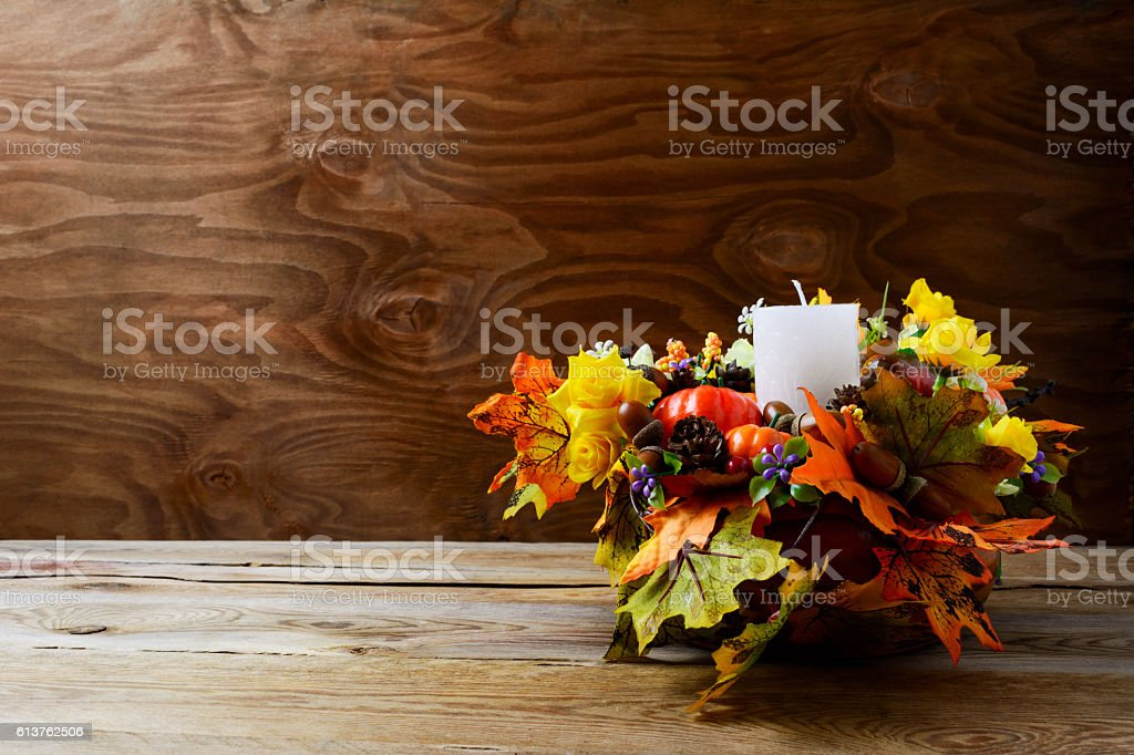 Thanksgiving decoration with silk fall leaves on rustic backgrou stock photo