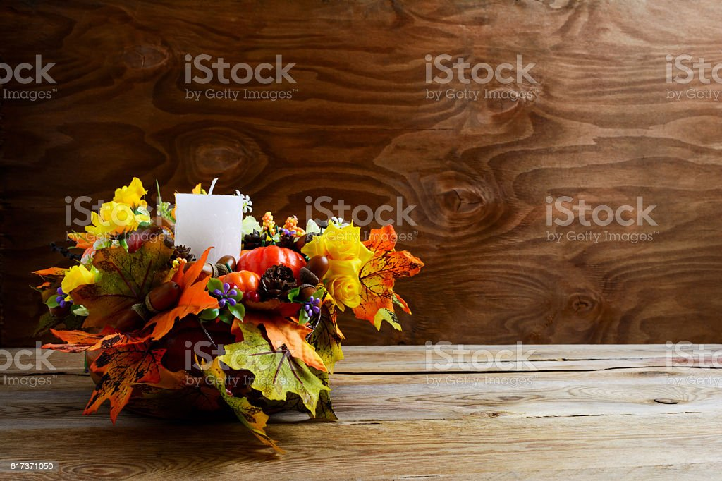 Thanksgiving decoration with silk leaves on rustic background stock photo