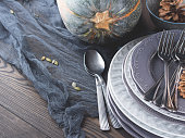 Thanksgiving dinner still life with squash and plates