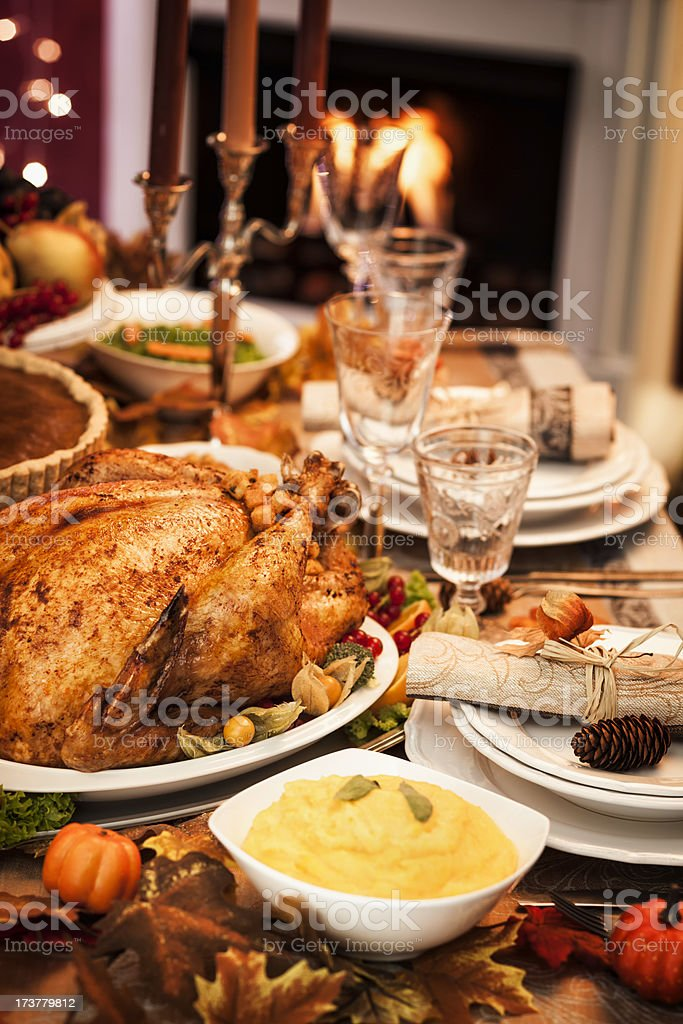Thanksgiving Dinner with Stuffed Turkey and Side Dishes stock photo