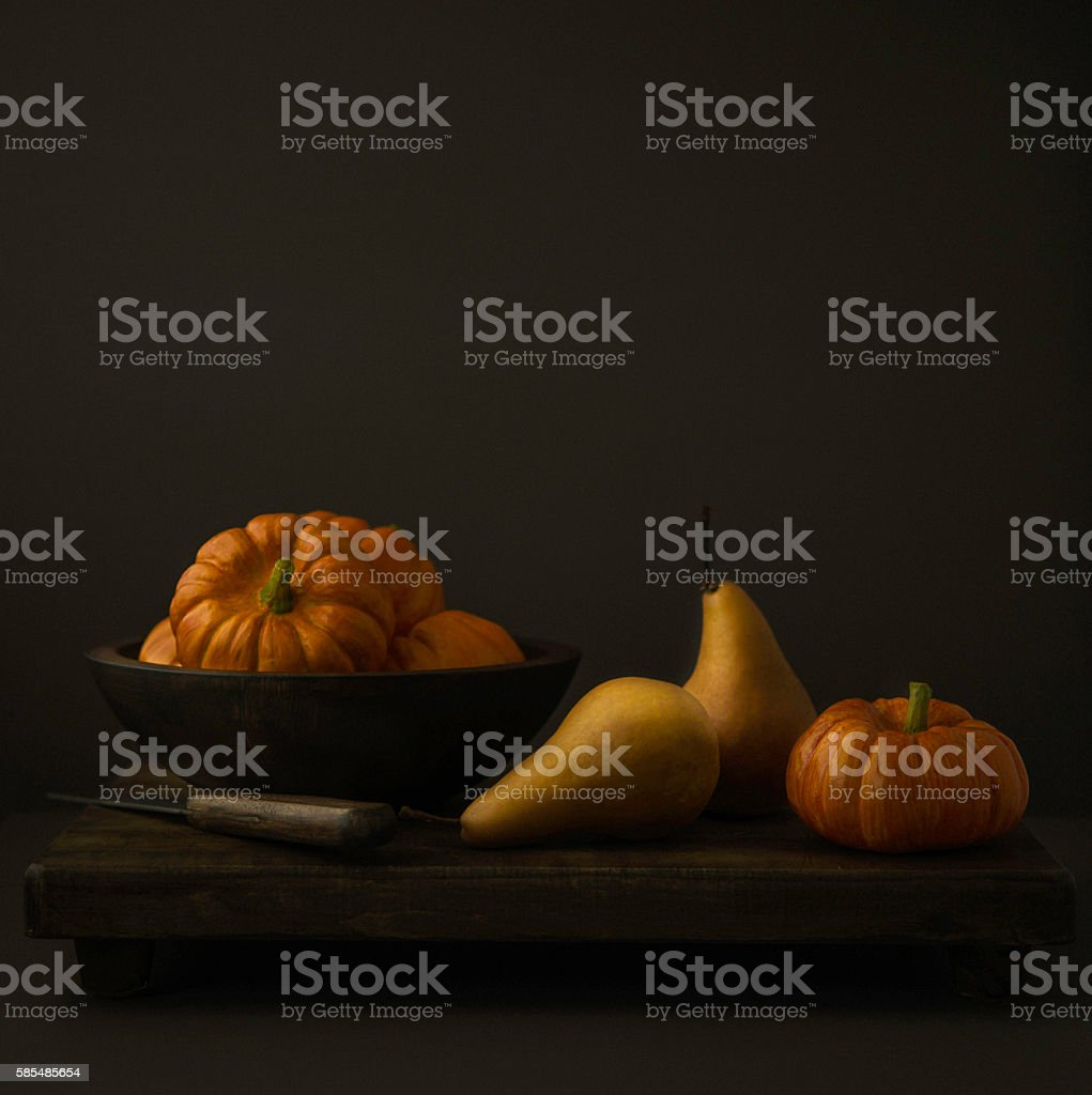 Thanksgiving Fall themed still life with pears and pumpkins stock photo