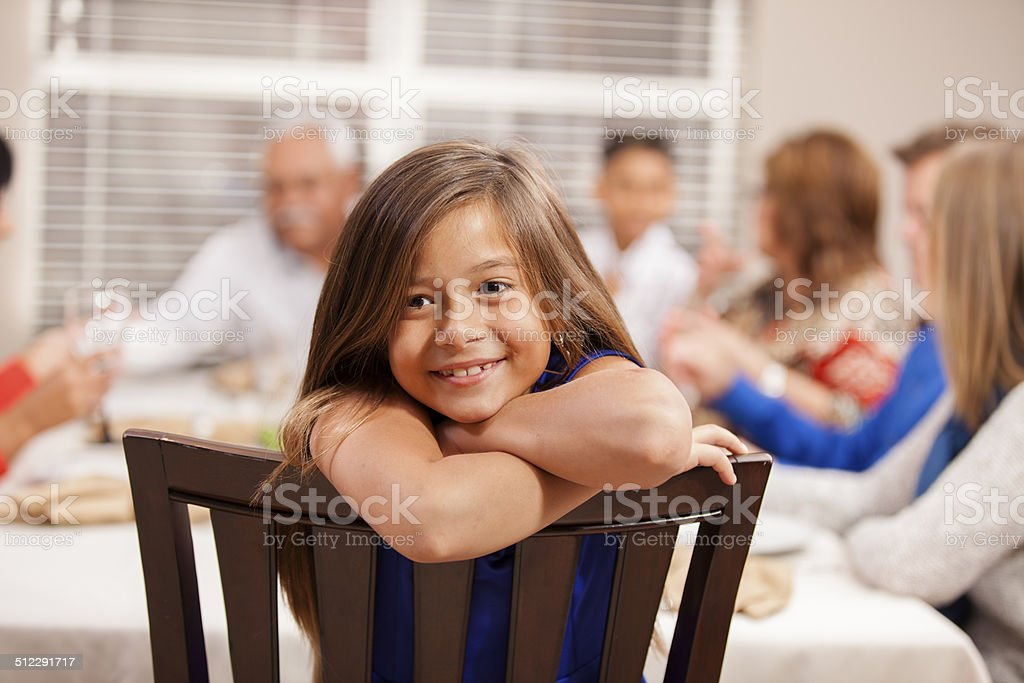 Thanksgiving: Family and friends gather for dinner at grandpa's house. stock photo