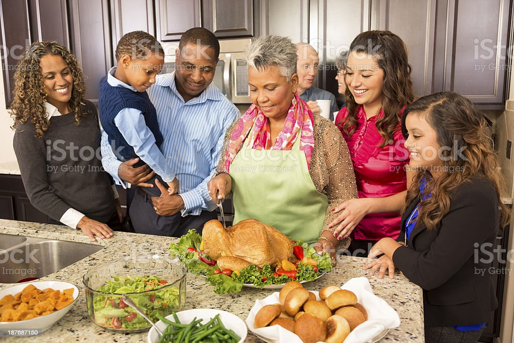 Thanksgiving:  Family and friends gather in kitchen to prepare meal. stock photo