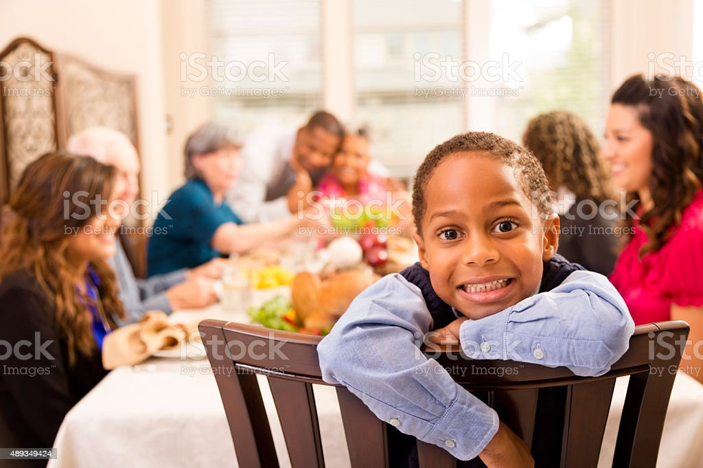 Thanksgiving: Family gathers for dinner at grandma's house. Little boy. stock photo