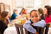 Thanksgiving: Family gathers for dinner at grandma's house. Little boy.