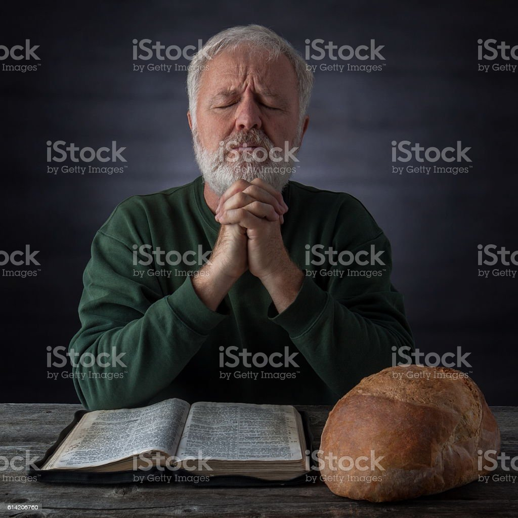 Thanksgiving prayer for spiritual and daily bread stock photo