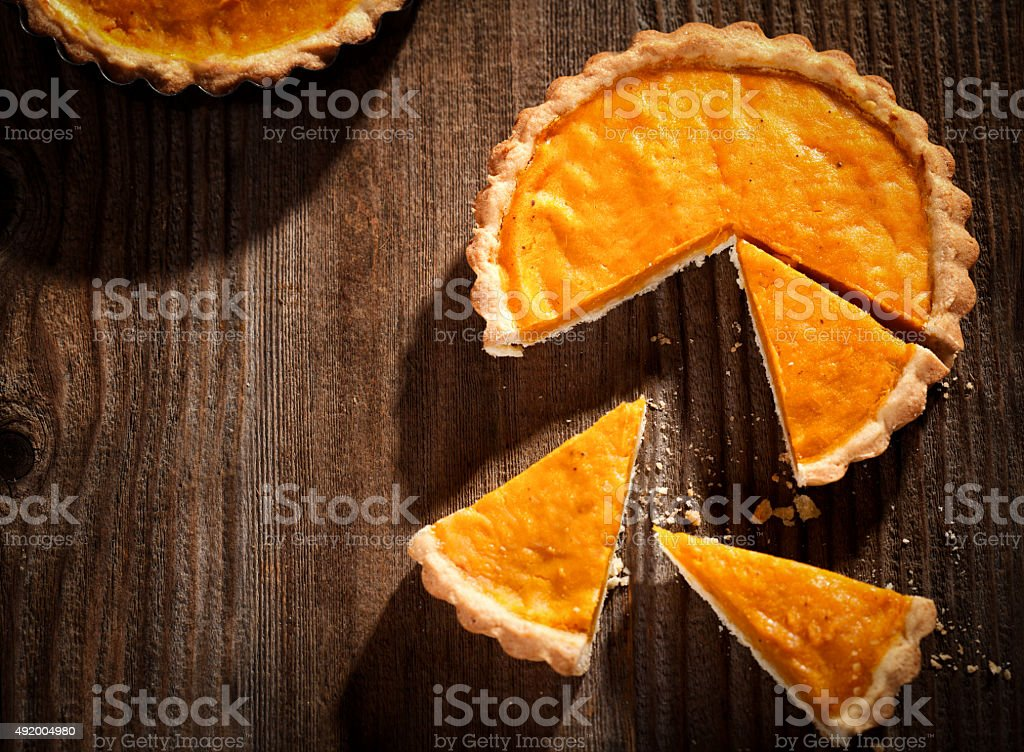 Thanksgiving pumpkin pie on a wooden table stock photo
