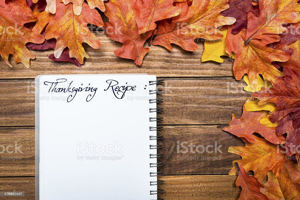 Thanksgiving recipe on Autumn leaves background royalty-free stock photo