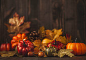 Thanksgiving still life background with pumpkins and autumn leaves