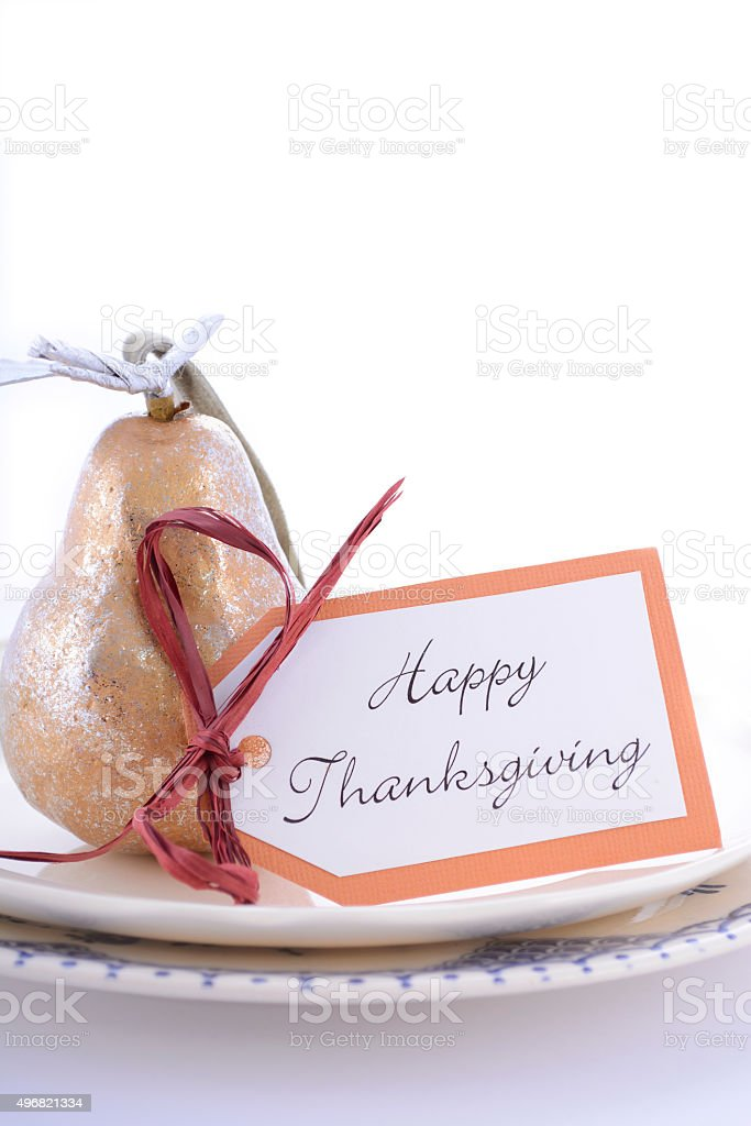 Thanksgiving table setting with gold pear. stock photo