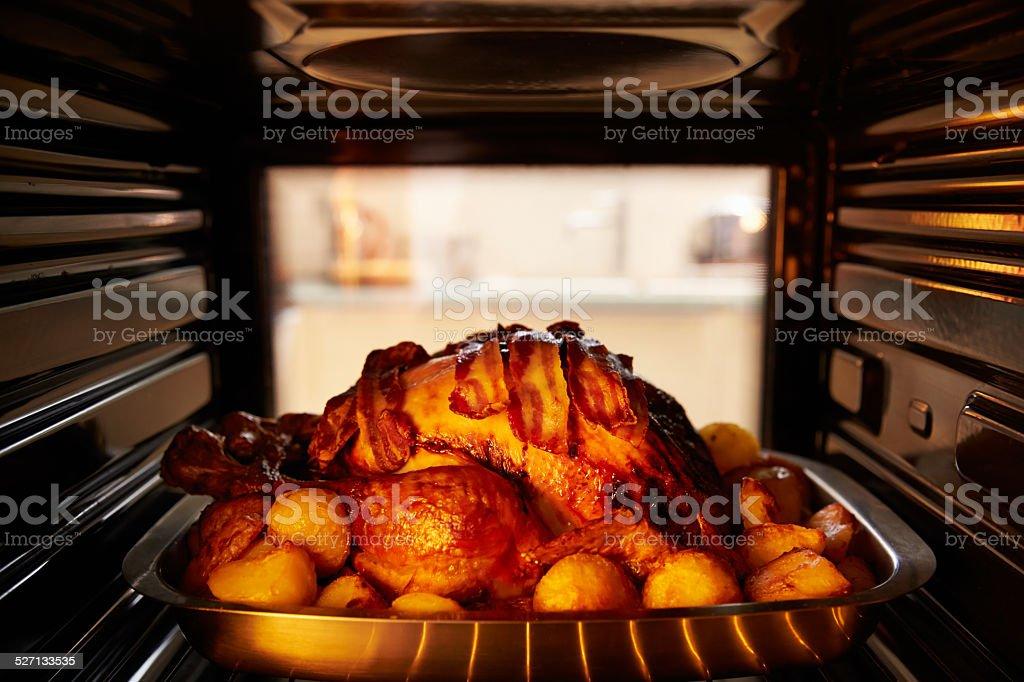 Thanksgiving Turkey Roasting Inside Oven stock photo