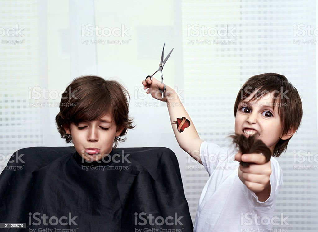 that evil look of little hairdresser stock photo