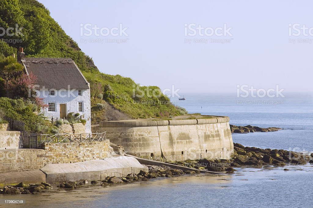 Thatched Cottage By The Sea royalty-free stock photo