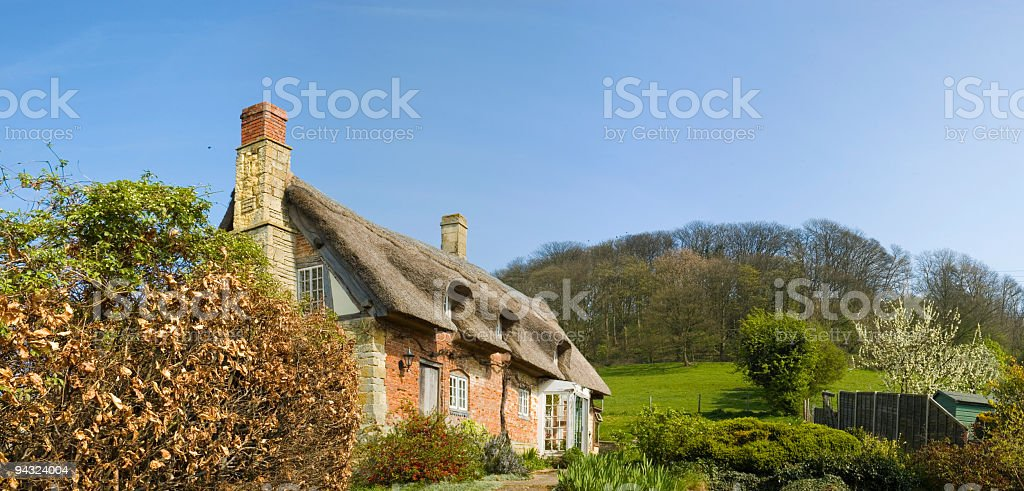Thatched cottage, green hill royalty-free stock photo