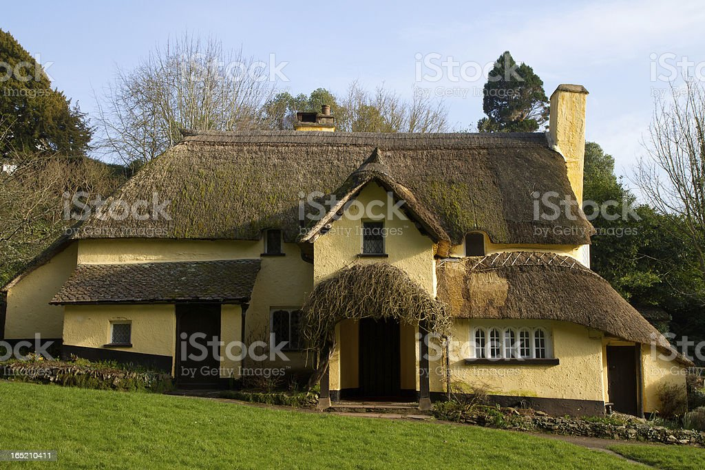 Thatched cottage in an English village royalty-free stock photo