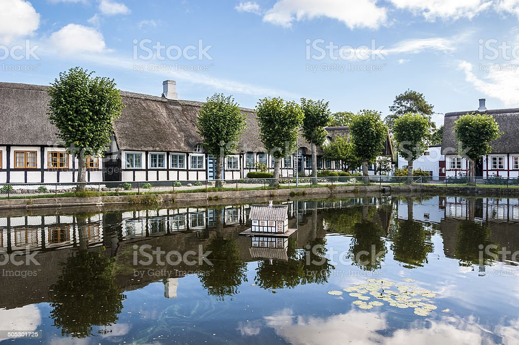 Thatched Cottages and Village Pond royalty-free stock photo