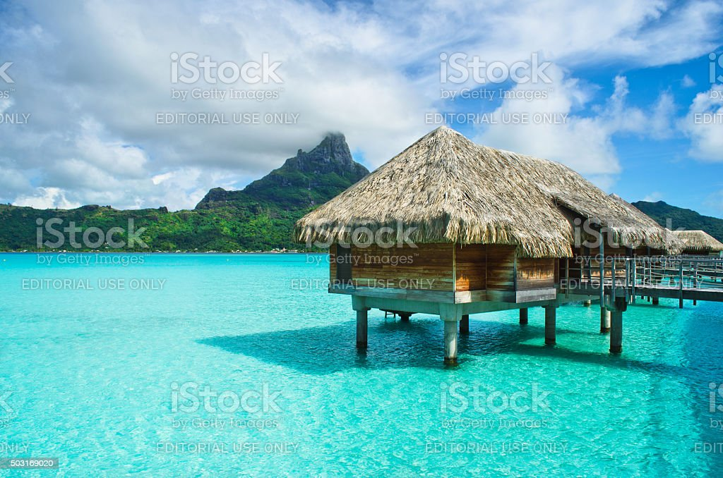 Thatched roof honeymoon bungalow on Bora Bora stock photo