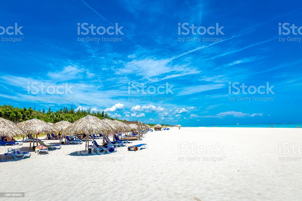 Thatched umbrellas on a beautiful summer day stock photo