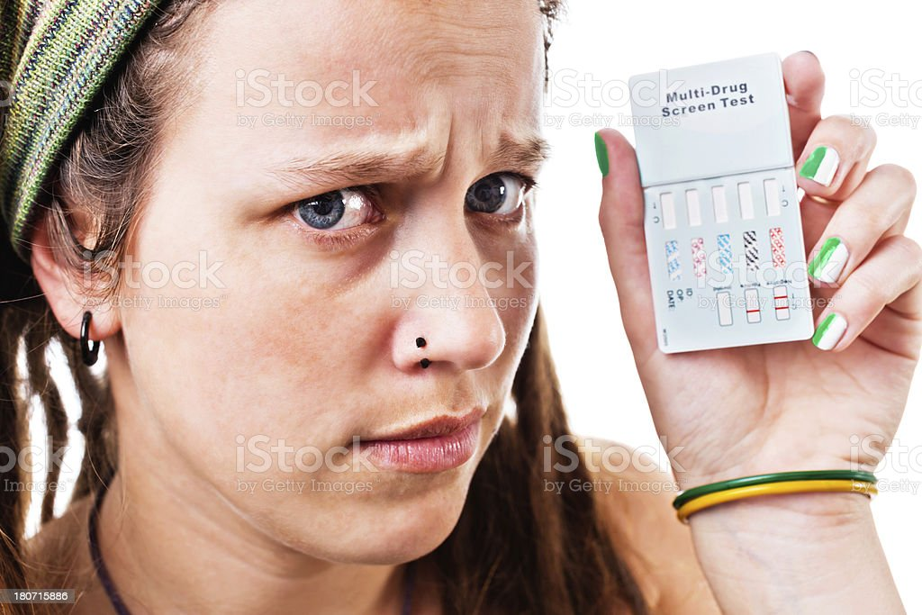 That's bad! Worried woman holds up drug test  kit stock photo