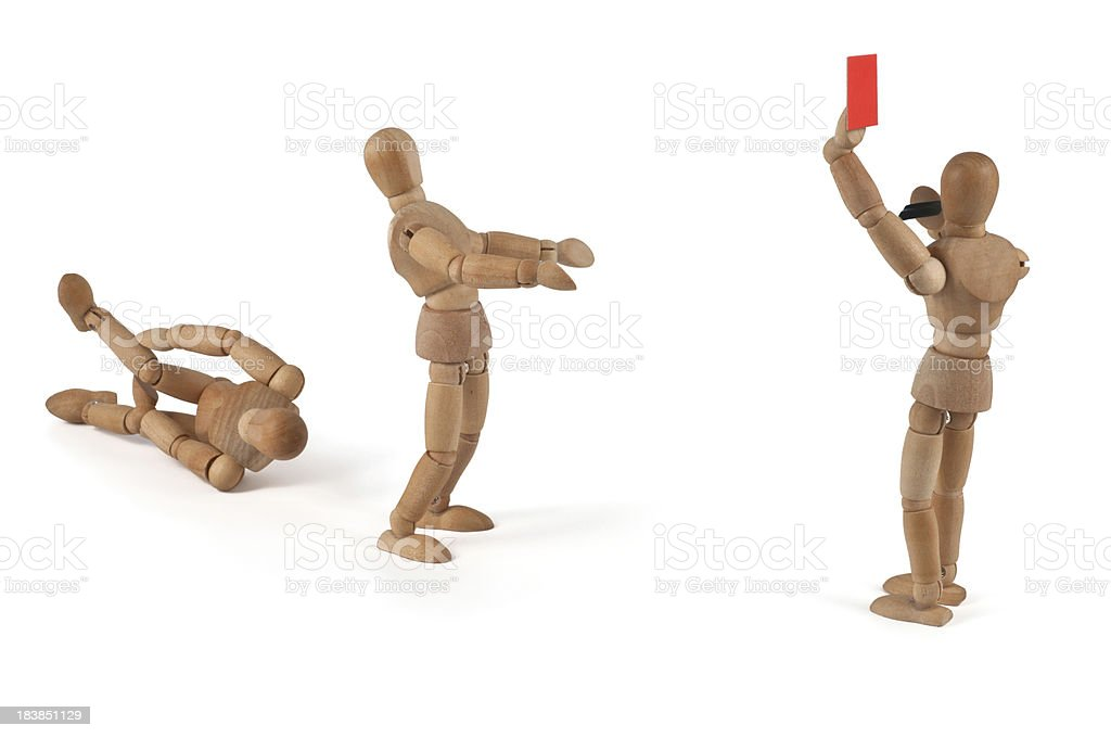 Thats unfair! Wooden mannequin gets the red card stock photo