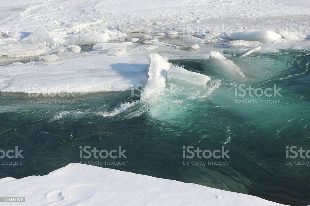 Thawing of ice on the river in the early spring stock photo