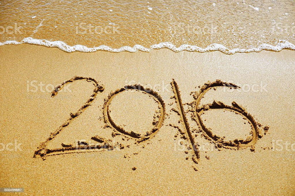 The 2016 written on the sandy beach close-up stock photo