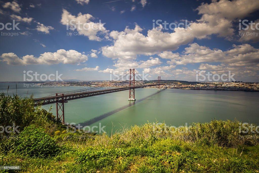 The 25 de Abril Bridge is a bridge connecting stock photo