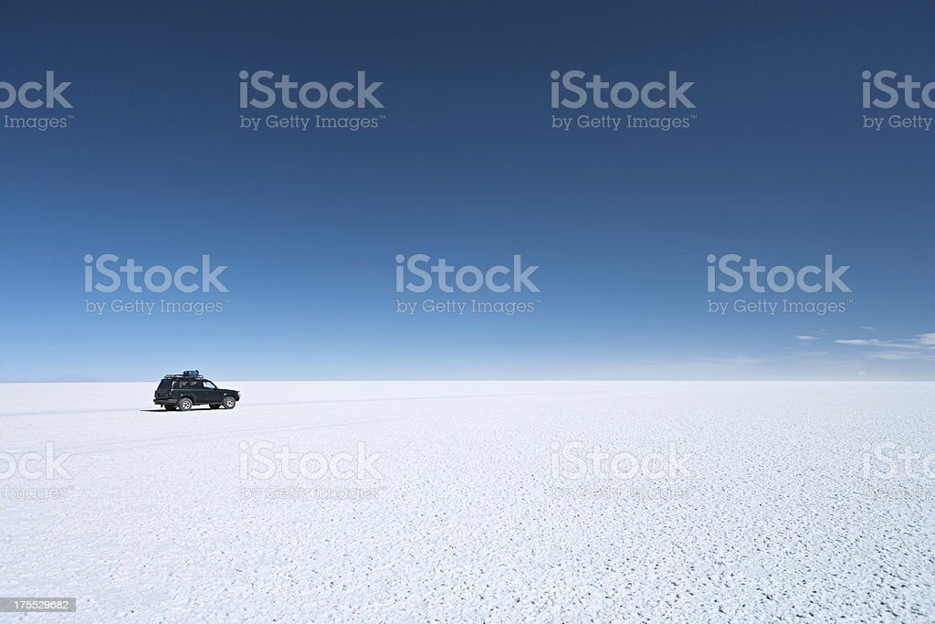 The 4WD on Salar de Uyuni, Altiplano Bolivia stock photo
