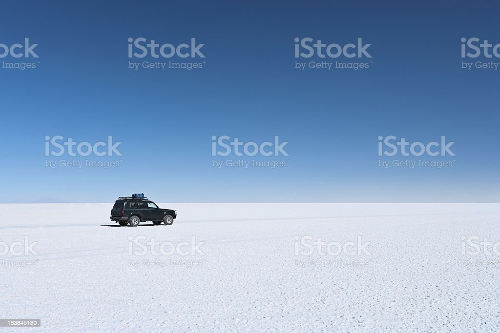 The 4WD on Salar de Uyuni, Altiplano Bolivia royalty-free stock photo