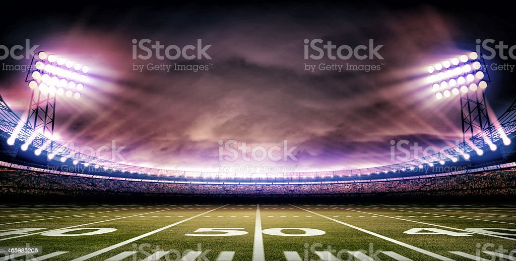 The 50-yard line close-up of American football stadium stock photo