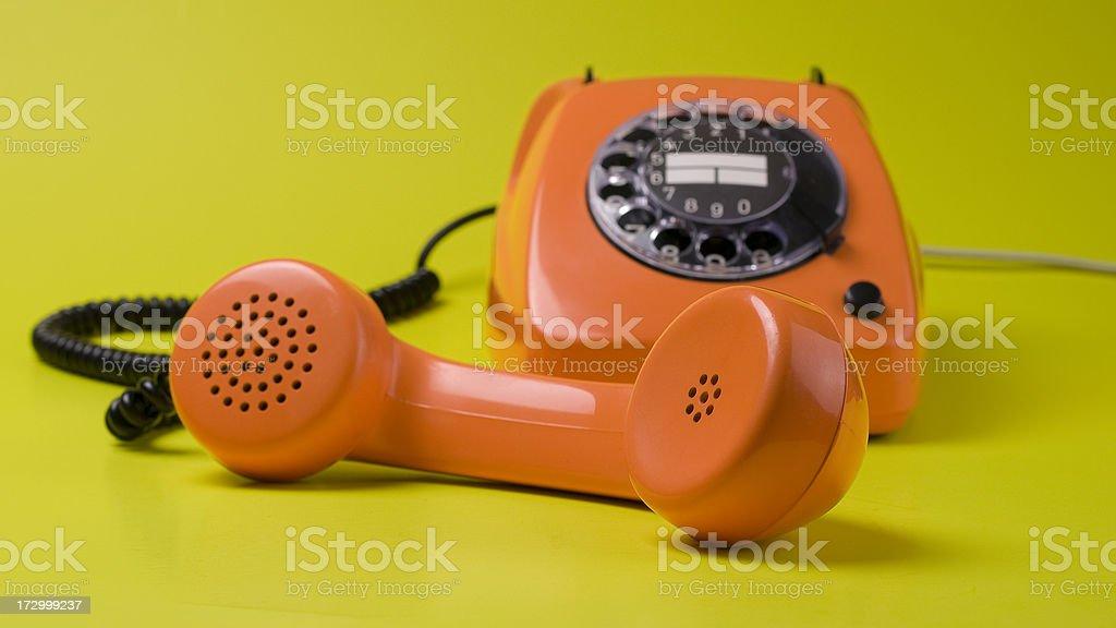 The 70s. orange telephone royalty-free stock photo