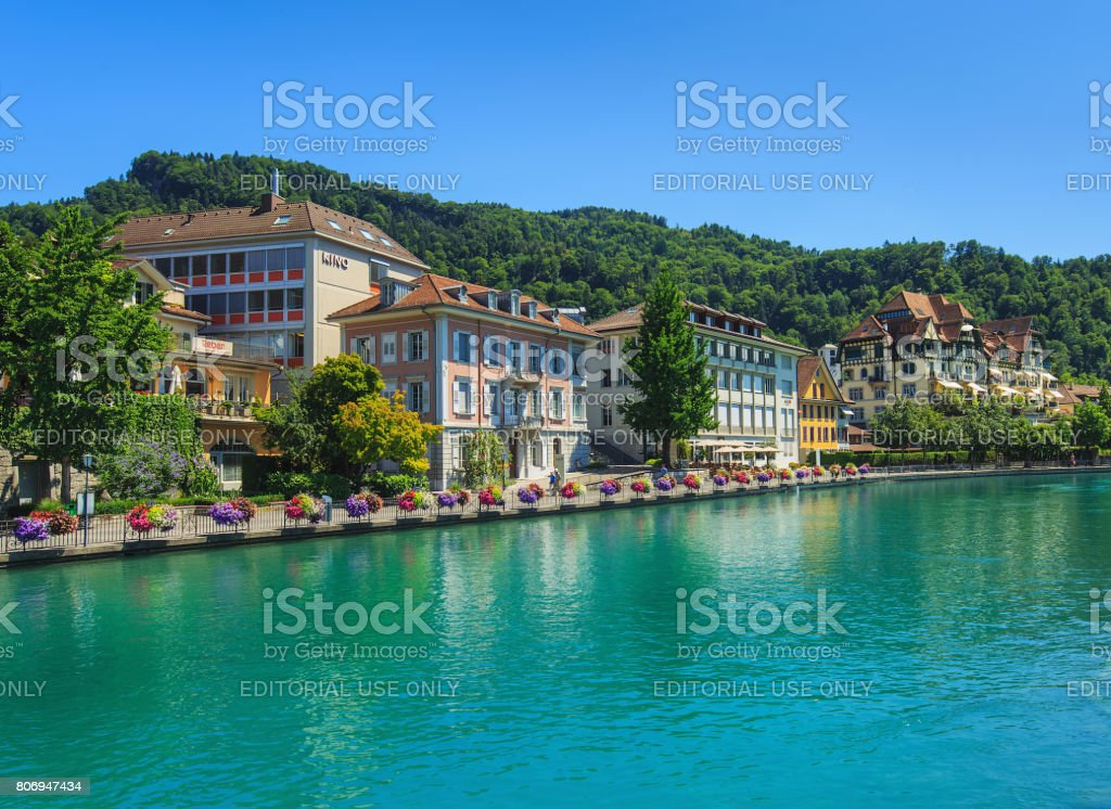 The Aare river and buildings along it in the city of Thun, Switzerland stock photo
