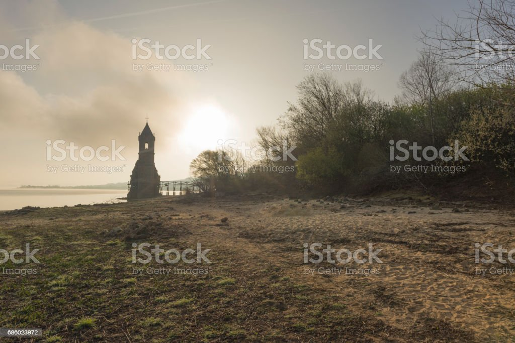 The abandoned tower of the ebro reservoir in Cantabria stock photo