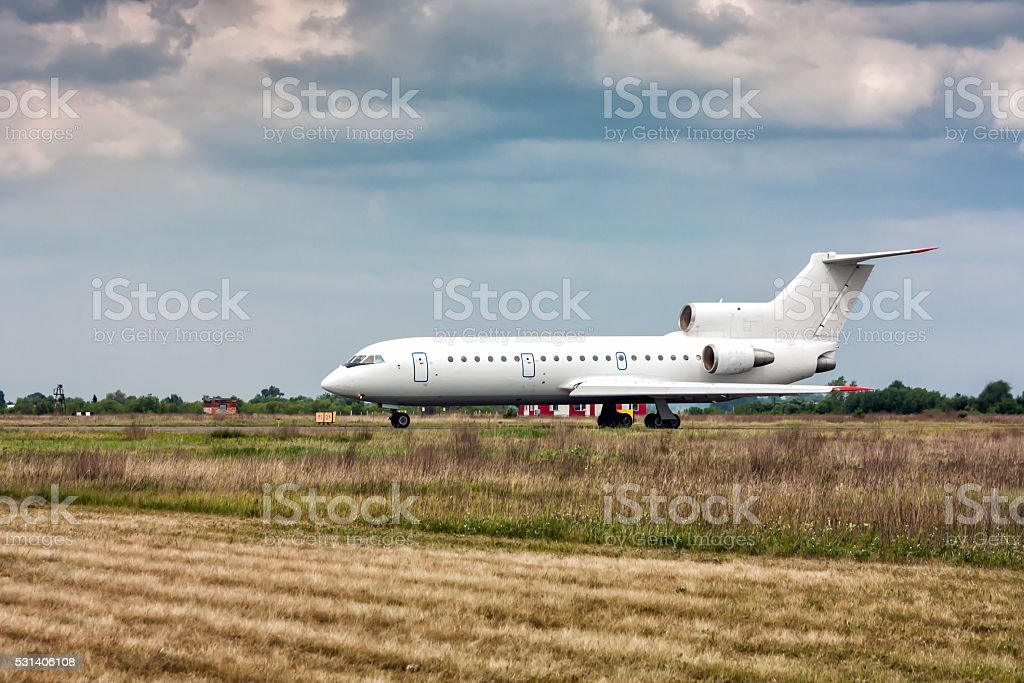 The aircraft taxiing on the main taxiway in a small airport royalty-free stock photo