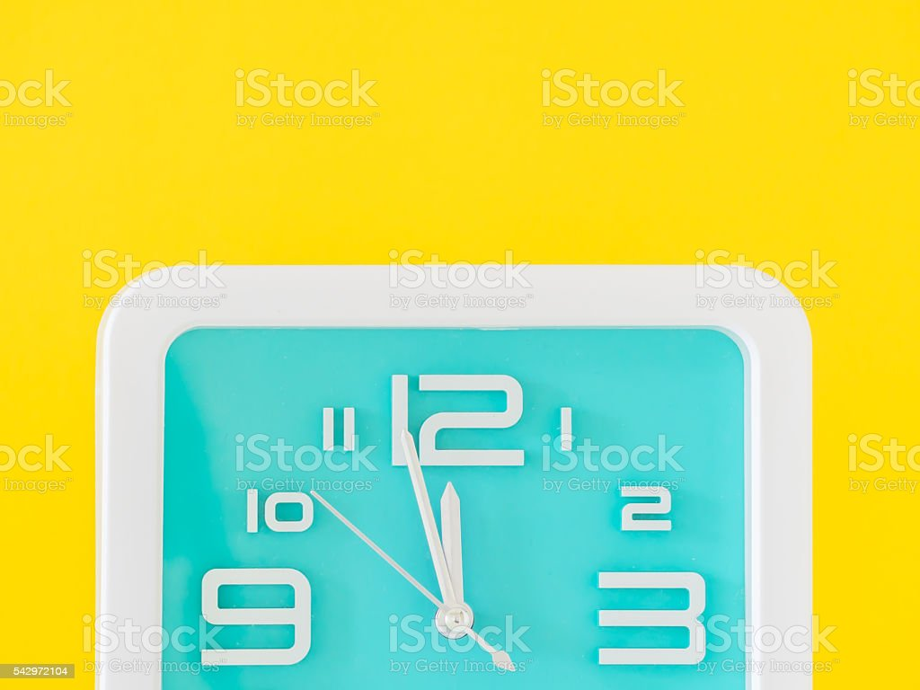 The alarm clock is showing the midday or midnight. stock photo