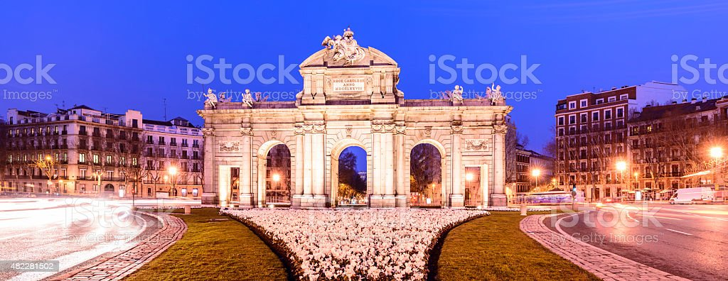 The Alcala Gate Illuminated at Twilight in Madrid Spain stock photo