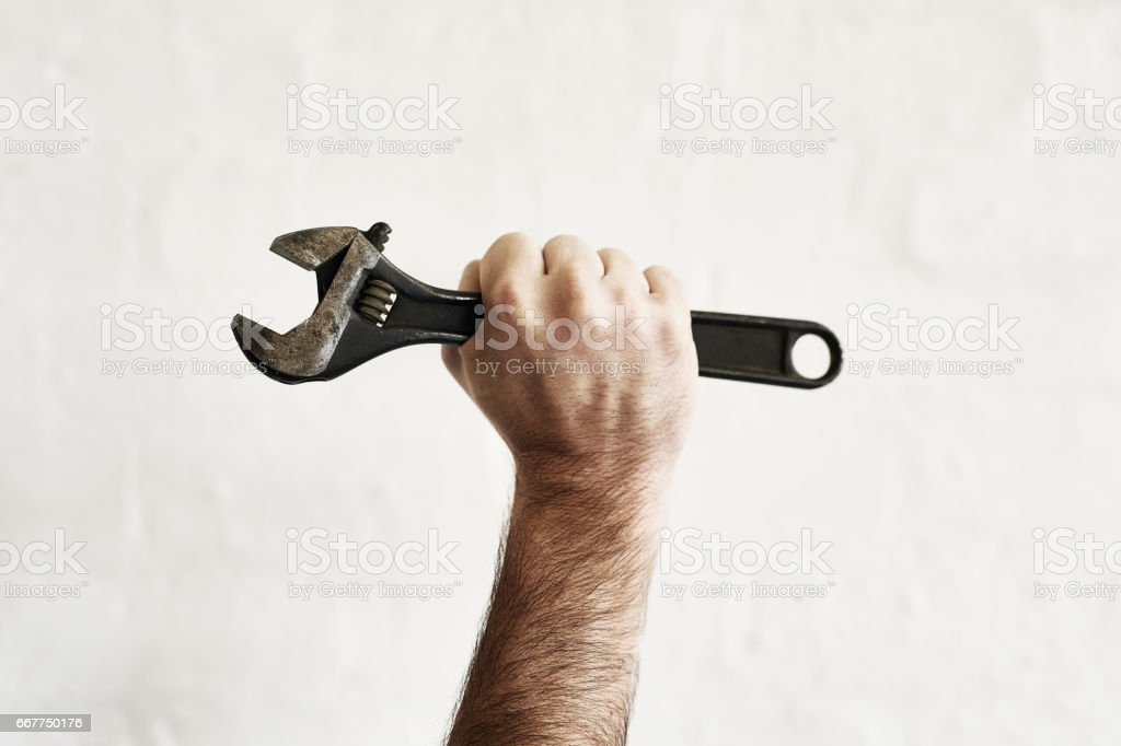 The all powerful monkey wrench stock photo