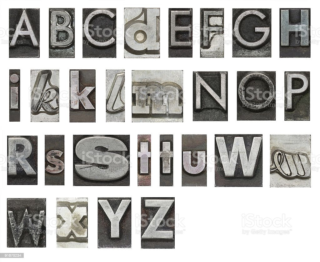 The alphabet cut out of words, isolated on white stock photo