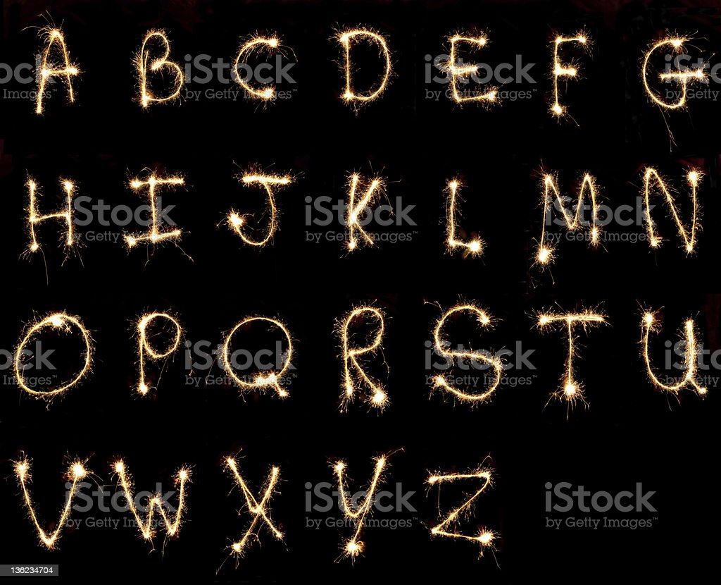 The alphabet painted with sparklers stock photo