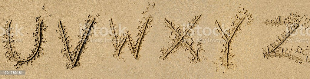 The alphabet written in sand royalty-free stock photo
