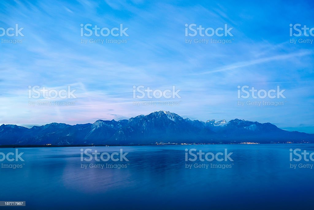 The Alps over Lake Geneva at dawn stock photo