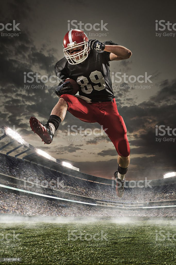The american football player in action stock photo