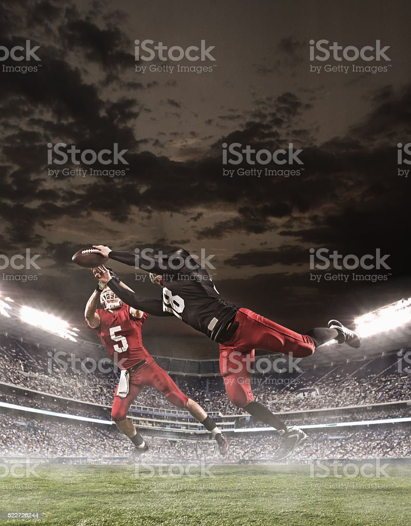 The american football players in action stock photo