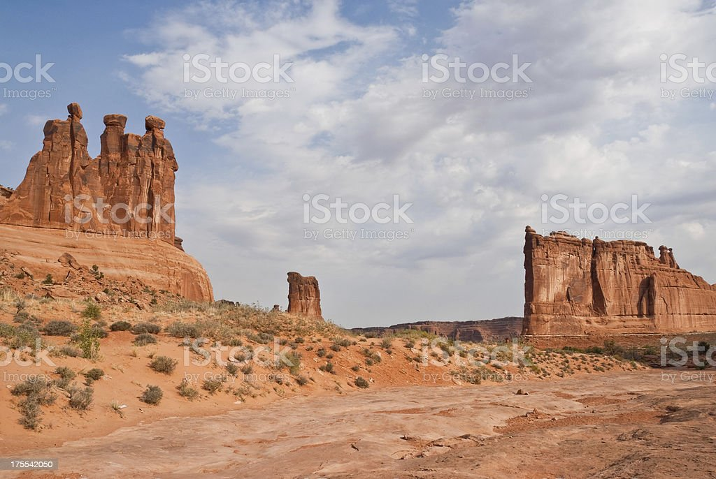The Three Gossips, Sheep Rock  and Courthouse Tower stock photo