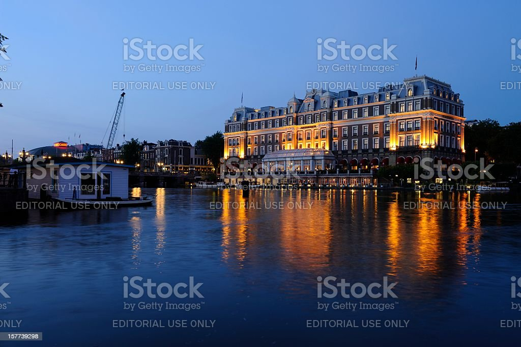 The Amstel Hotel in Amsterdam at dusk royalty-free stock photo