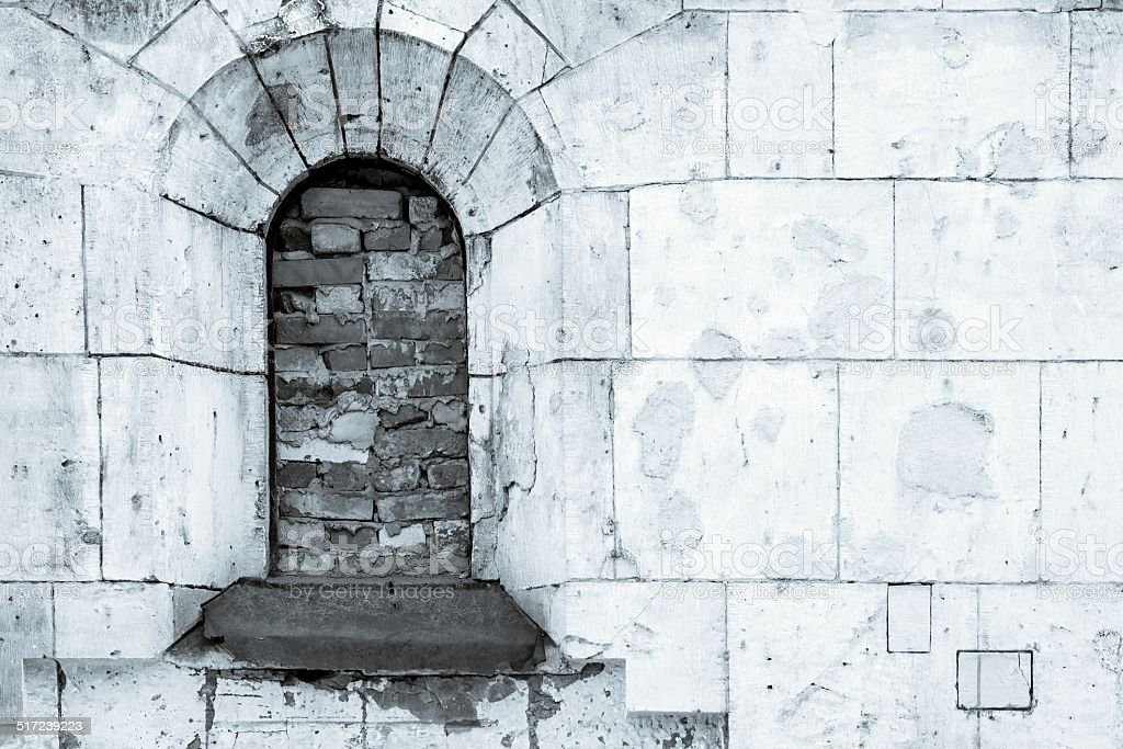 the ancient destroyed facade in monochrome tones stock photo