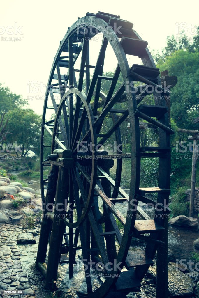 The ancient water wheel stock photo